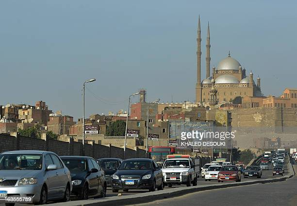 Egyptian motorists drive past the Mohammed Ali mosque in Cairo on March 11 2013 The political and economic crisis in Egypt has affected the imports...
