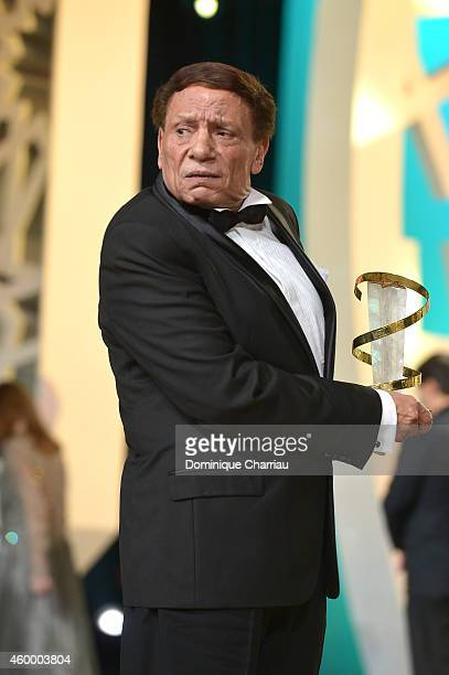 Egyptian movie and stage actor Adel Emam receives a tribute award during the 14th Marrakech International Film Festival Opening Ceremony on December...