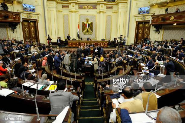 Egyptian MPs attend a Parliament session to view the report of the parliament's Legislative and Constitutional Affairs Committee regarding the...