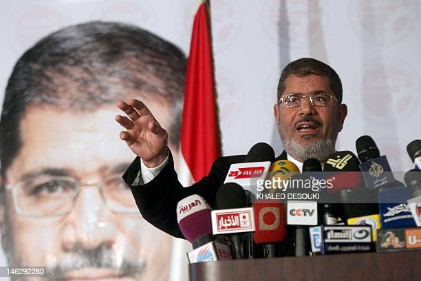 Egyptian Muslim Brotherhood candidate for the presidential elections Mohammed Mursi gestures as he gives a press conference in Cairo on June 13 2012...