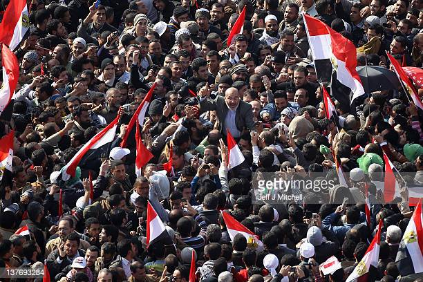 Egyptian Muslim Brotherhood Elder Safwat Hegazy is carried through Tahrir Square as thousands gather to mark the one year anniversary of the...