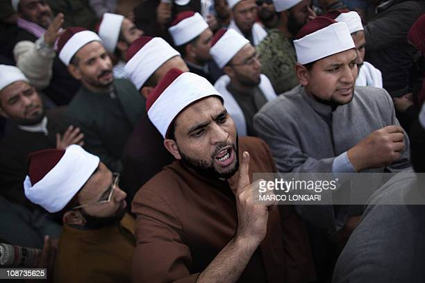 Egyptian Muslim clerics shout slogans as they gather in Cairo's Tahrir Square heeding a call by the opposition for a march of a million to mark a...