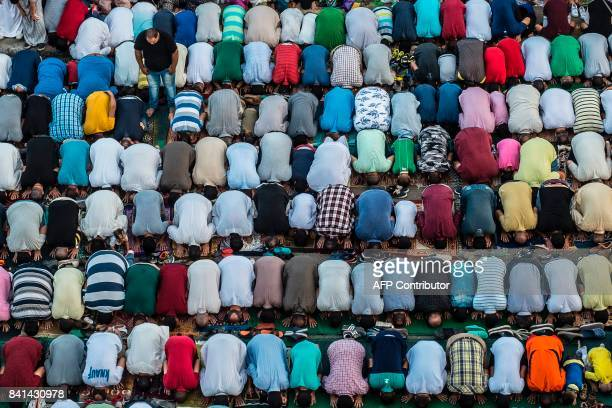 Egyptian Muslim devotees perform the morning Eid alAdha prayer inside alSedik mosque in the northeastern suburb of Sheraton in the capital Cairo on...