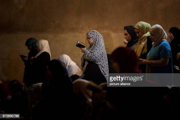 Egyptian Muslim women read verses of Quran Islam's holy book as they perform the 'Tarawih' evening prayers during the holy fasting month of Ramadan...