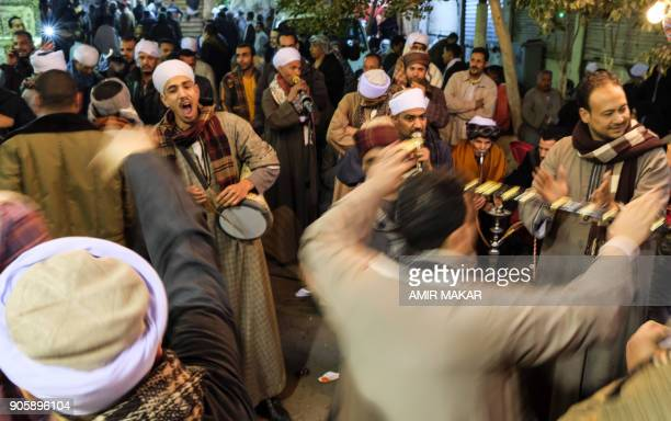 Egyptian Muslims attend a ceremony to commemorate the birth of Imam Hussein the grandson of Prophet Mohammed outside alHussein mosque in Cairo late...