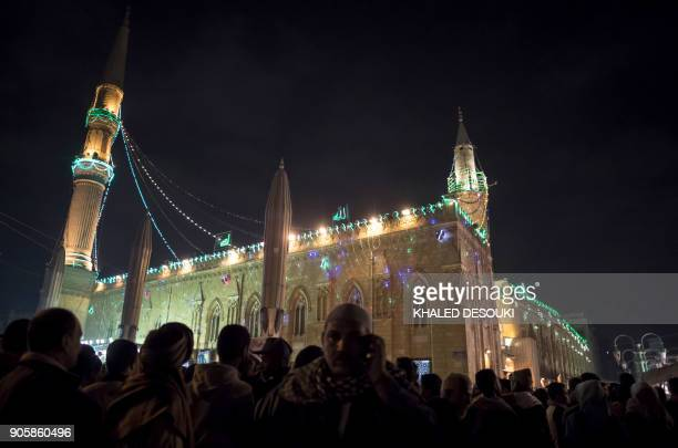 TOPSHOT Egyptian Muslims attend a ritual ceremony to commemorate the birth of Imam Hussein the grandson of the Prophet Mohammed outside alHussein...