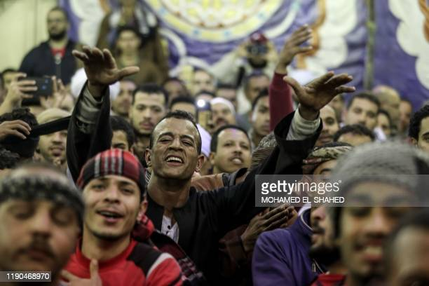 Egyptian Muslims dance and chant as they attend a spiritual ceremony to commemorate the final night of the Mawlid festival of Imam Hussein the...