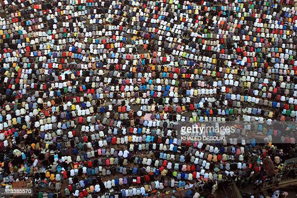 Egyptian Muslims gather to pray celebrating the start of the threeday feast known in Arabic Eid alFitr which marks the end of the holy fasting month...