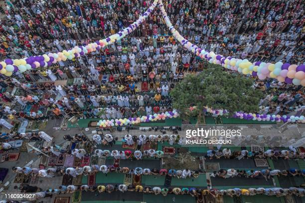 Egyptian Muslims perform the Eid AlAdha morning prayer outside alSedik mosque in the northeastern suburb of Sheraton in the capital Cairo on August...