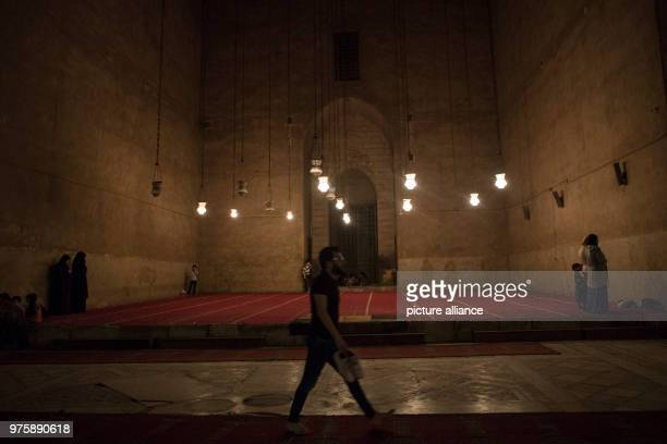Egyptian Muslims perform the 'Tarawih' evening prayers during the holy fasting month of Ramadan at alSultan Hassan mosque in Cairo Egypt 23 May 2018...