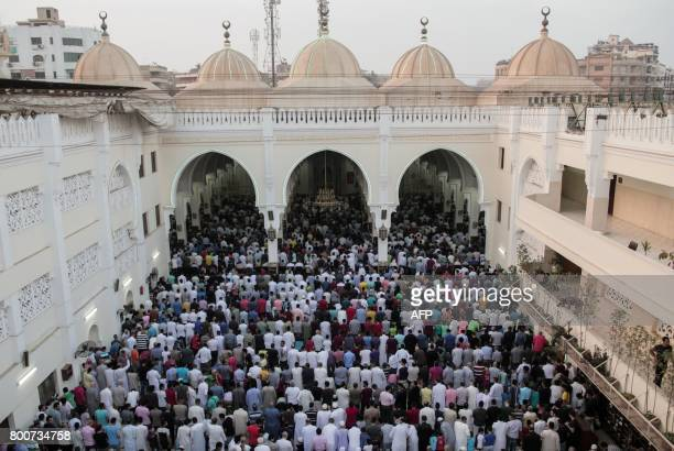 Egyptian Muslims pray at a mosque on the first day of Eid alFitr holiday that marks the end of the holy fasting month of Ramadan on June 25 in the...