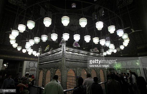 Egyptian Muslims pray at a tomb in alHussein mosque where according to belief the head of Imam Hussein the grandson of prophet Mohammed is buried in...