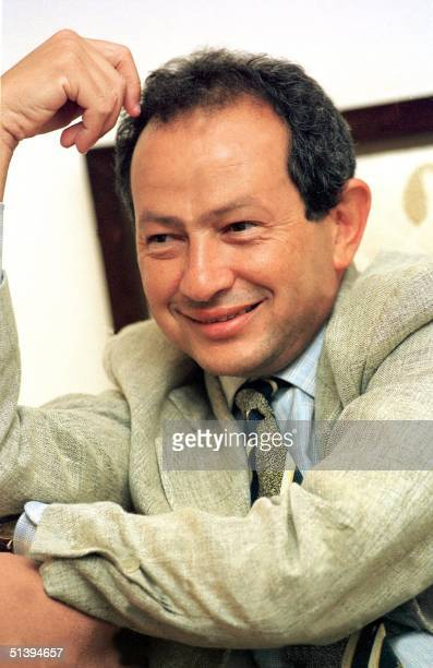 Egyptian Naguib Sawiris chairman of Egypt's Orascom Telecom smiles as he answers reporters questions in Cairo Egypt's Orascom Telecom is emerging as...
