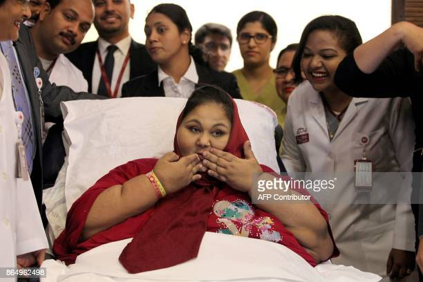 Egyptian national Eman Ahmed Abd El Aty blows a kiss during a press conference on July 24 2017 at the Burjeel Hospital in Abu Dhabi where she is...