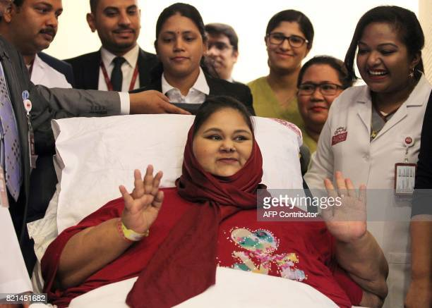 Egyptian national Eman Ahmed Abd El Aty waves during a press conference on July 24 2017 at the Burjeel Hospital in Abu Dhabi where she is receiving...