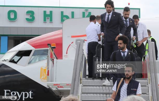 Egyptian national team football player and Liverpool's star striker Mohamed Salah disembarks from the plane with his team at Grozny International...