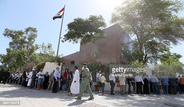 Egyptian nationals residing in the United Arab Emirates wait in line to cast their ballot at the Egyptian embassy in Dubai on May 15 2014 Exarmy...