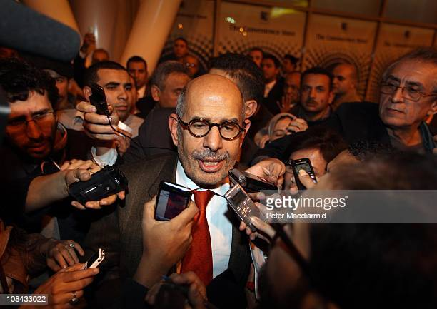 Egyptian opposition leader Mohamed ElBaradei is surrounded by reporters as he arrives at Cairo airport on January 27, 2011 in Cairo, Egypt. Mr...