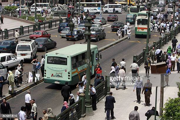 Egyptian pedestrians and traffic clog the streets in downtown Cairo on May 4 despite calls for strikes amid a wave of popular discontent at price...