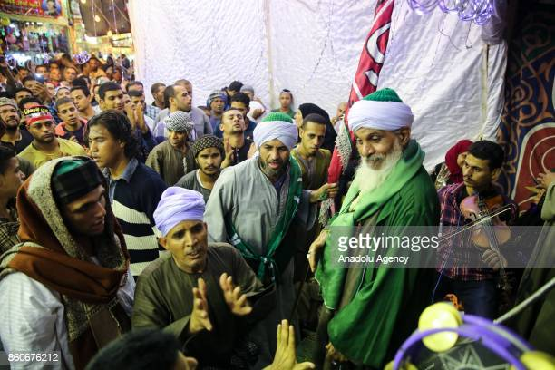Egyptian people attend the birthday celebrations of the founder of the Badawiyyah Sufi order Ahmad alBadawi at Seyyid AlBadawi Mosque in Tanta Egypt...