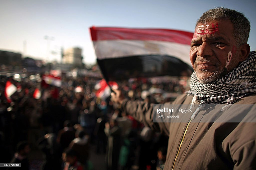 Egyptian people continue to demonstrate in Tahrir Square on January 26, 2012 in Cairo, Egypt. Tens of thousands of Egyptian people gathered yesterday to celebrate the anniversary of the start of the uprising which ended President Hosni Mubarak's rule.