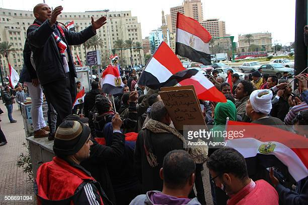 Egyptian people hold flags and chant slogans during a demonstration in support of Egyptian President Abdel Fattah alSisi at Tahrir square in Cairo...