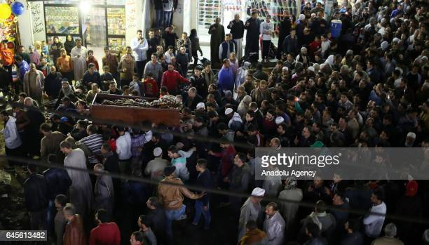 Egyptian people mourn around the body of Muhammed Ebuterike father of the veteran national football player Muhammed Muhammed Ebuterike during a...