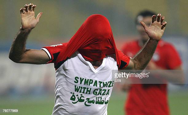 Egyptian player Mohamed Abou Traika wears a tee shirt reading Sympathize with Gaza as he celebrates his goal 10 against Sudan in Kumasi 26 January...