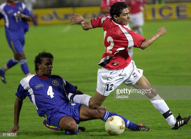 Egyptian player Mohammed Barakat battles for the ball against Mauritius's player Steve Garen during their African Nations Cup Group 10 qualifying...