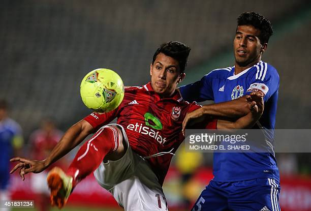 Egyptian player of alAhly club Amr Gamal fights for the ball with Farid alSayed from Smouha club during their football match in the final of Egypts...
