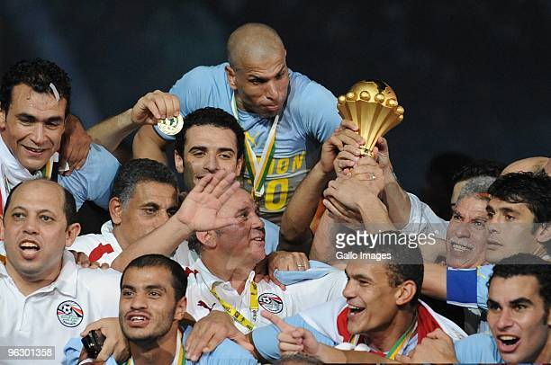 Egyptian players and coaching staff celebrate winning the Africa Cup of Nations final match between Ghana and Egypt from Universitaria Stadium on...