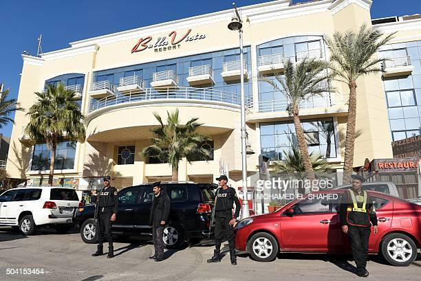 Egyptian police and security stand guard in front of the Bella Vista Hotel in Egypt's Red Sea resort of Hurghada on January 9 the day after the hotel...