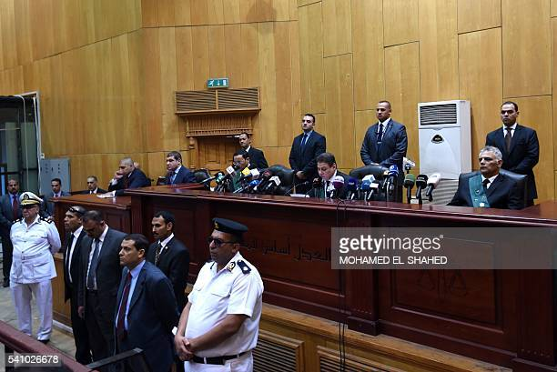 Egyptian police lawyers and a judge attend ousted Islamist president Mohamed Morsi's trial on espionage charges at a court in Cairo on June 18 2016...