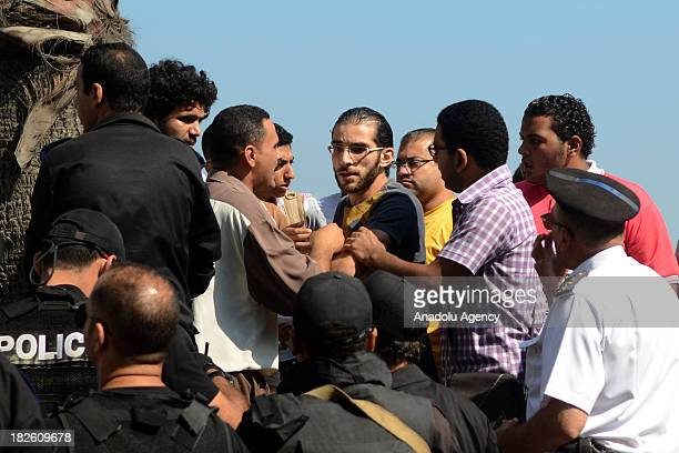 Egyptian police officers clash with supporters of 28-year-old Khaled Said who died following police questioning, during the trial of two Egyptian...