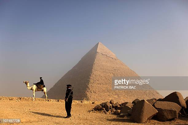 Egyptian police officers guard the Pyramid Khafre in Giza on the outskirts of Cairo on November 30 2010 AFP PHOTO/PATRICK BAZ
