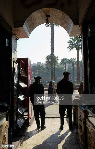 Egyptian police secure an entrance to the bazzar close to the AlHussein mosque in Cairo on February 23 the scene of a deadly bomb blast the previous...