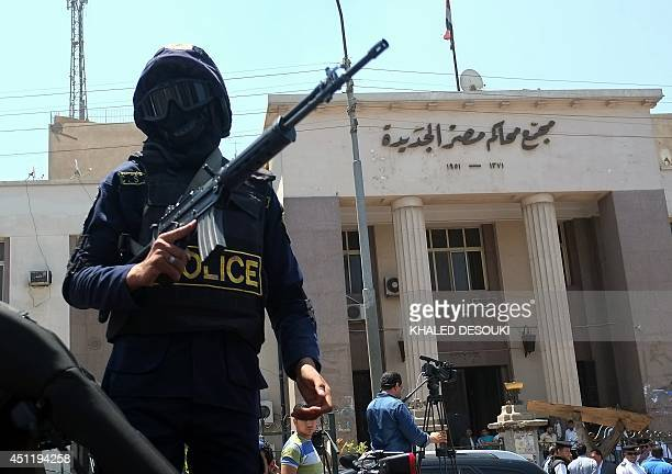 Egyptian police special forces secure the area outside a courthouse in the Cairo district of Heliopolis after a makeshift bomb that was placed under...