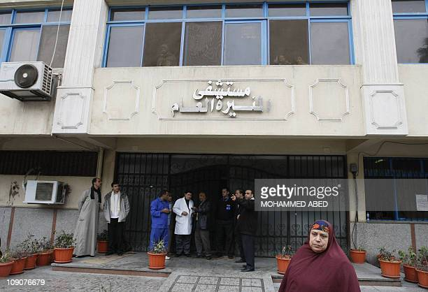 Egyptian police stand guard at the entrance of Cairo's Munira hospital on January 17 2011 where a man who set himself alight outside the parliament...