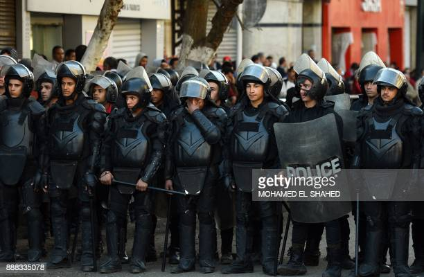Egyptian police stand guard during a demonstration against US President Donald Trump's decision to recognize Jerusalem as the capital of Israel at...