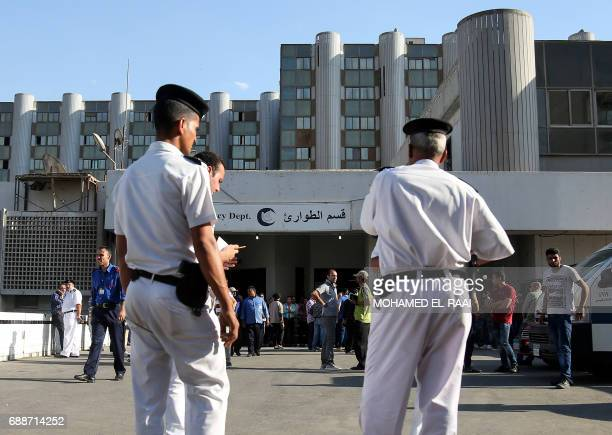 Egyptian police stand guard outside a hospital in Cairo's northern suburb of Shubra on May 26 following an attack in which 28 Coptic pilgirms were...