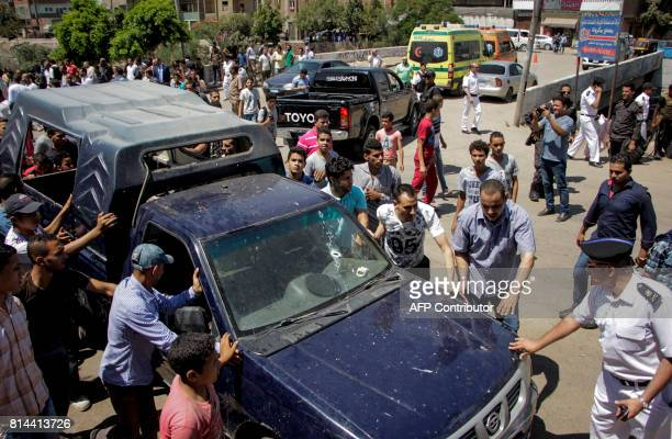 Egyptian policemen inspect the scene of an attack which left five of their colleagues killed in a shooting near Badrasheen a town some 20 kilometres...