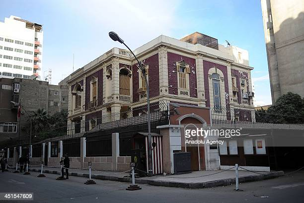 Egyptian policemen keep watch outside the Turkish embassy on November 23 2013 in Cairo Egypt Egypt downgraded diplomatic relations with Turkey and...