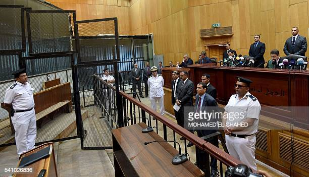 Egyptian policemen lawyers and judges attend ousted Islamist president Mohamed Morsi's trial on espionage charges at a court in Cairo on June 18 2016...