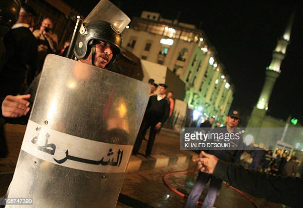 Egyptian policemen secure the site of an explosion in Cairo on February 22 2009 A French tourist was killed and 17 people among them other European...