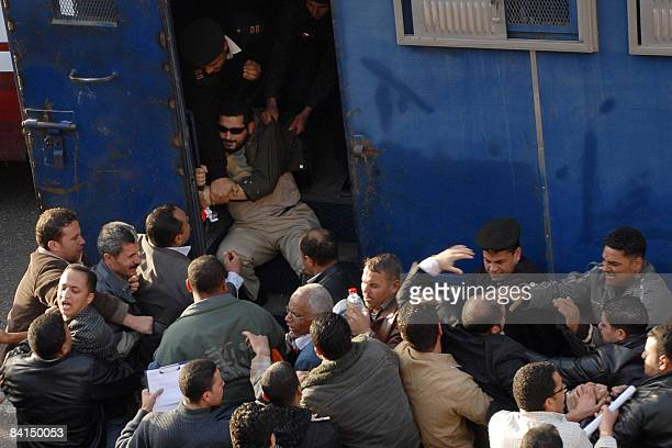 Egyptian policemen some in civil clothes arrest protestors of the Muslim Brotherhood during a demonstration in front the lawyers syndicate in...