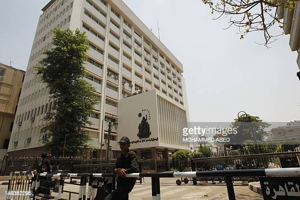 Egyptian Policemen stand guard as they close the road to the parliament building in central Cairo on June 15 2012 a day after Egypt's top court paved...