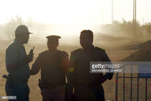 Egyptian policemen stand guard at the entrance of a road leading to Saint Samuel monastery in Minya province, some 260 kms south of the capital...