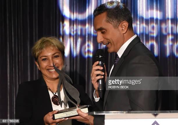 Egyptian political satirist Bassem Youssef receives the Badshah Khan Beacon of Truth Award from Ani Zonneveld president of Muslims For Progressive...