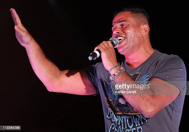 Egyptian pop star Amr Diab performs during a concert in the Emirati capital Abu Dhabi late on April 29 2011 AFP PHOTO/KARIM SAHIB