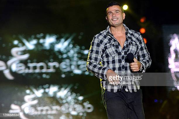 Egyptian pop star Amr Diab sings during a concert at the American University in Cairo on June 3 2011 AFP PHOTO/AMRO MARAGHI